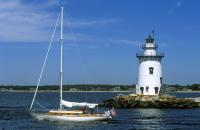 Lighthouse with Sail Boat